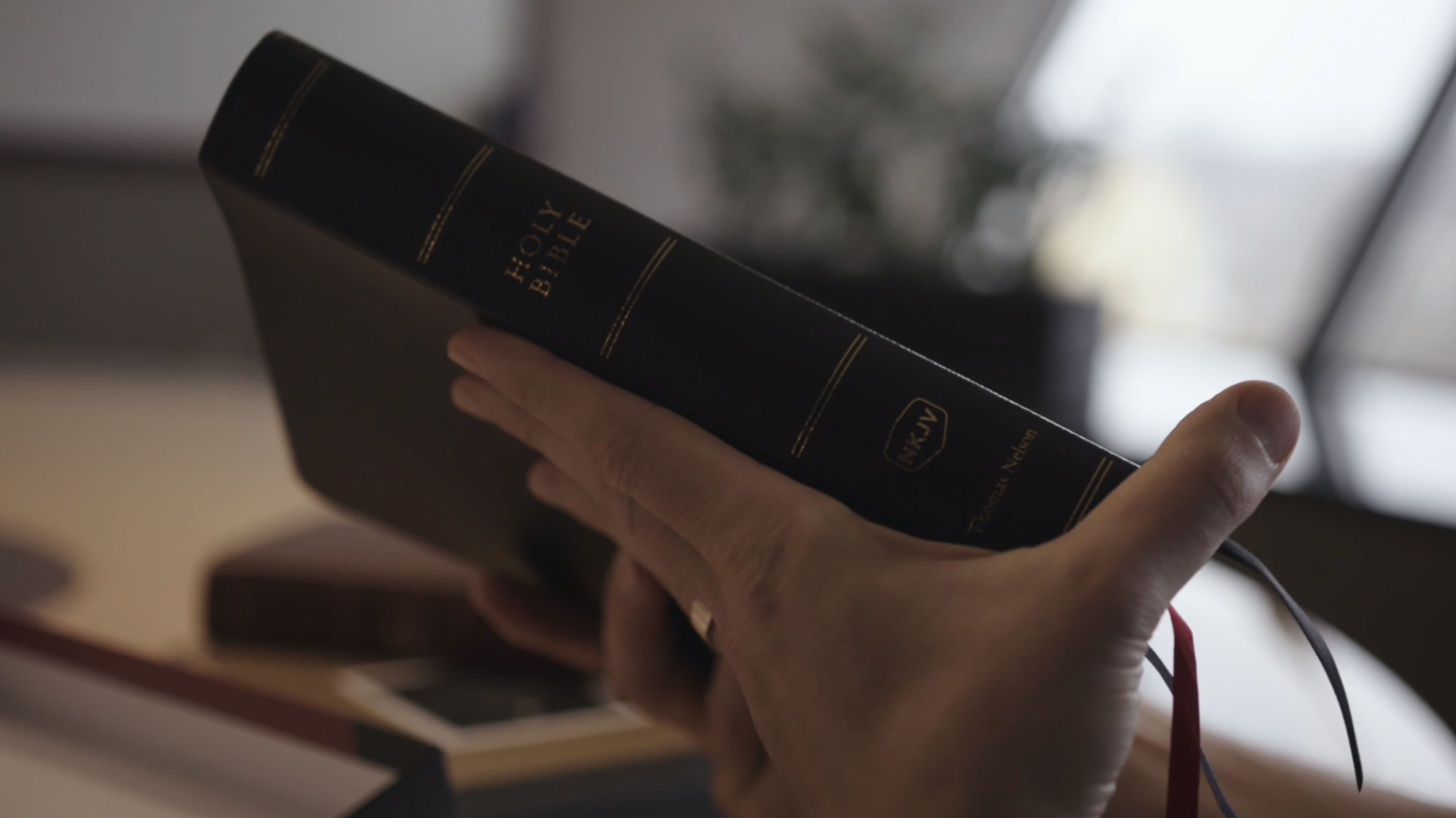 hand holding preaching Bible