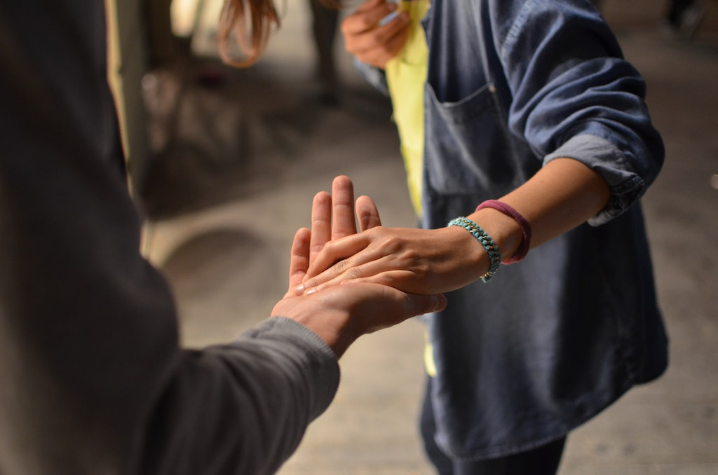 Person offering a helping hand to someone else